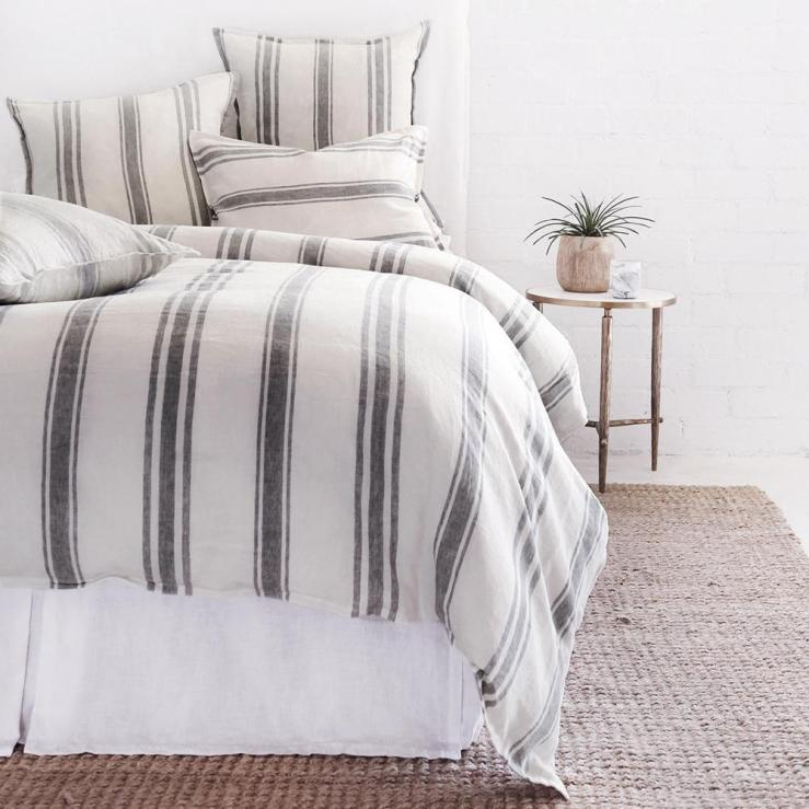 Farmhouse style bedding in flax and midnight grey stripe.