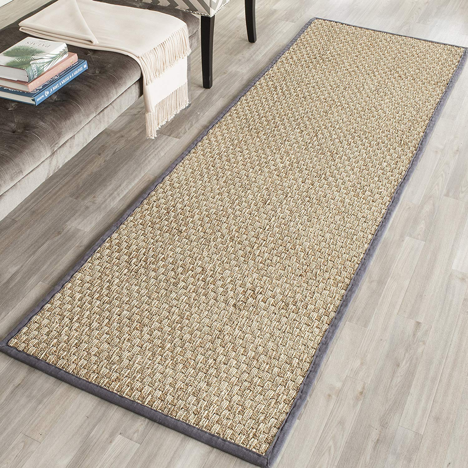 A woven rug brings in a quintessential farmhouse feel, this Safavieh Basketweave Natural and Dark Grey Rug could be used in an entryway or in front of the kitchen sink to add contrast and texture to your space.